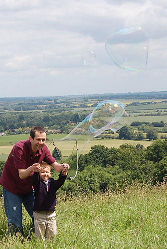 Boys blowing bubble